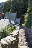 Cobbeledstraat in clovelly Noord-Devon het UK stock afbeelding