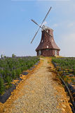 Cobber way to hilltop windmill Stock Photo