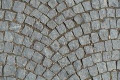 Cobble οδός πετρών που στρώνει το στρογγυλευμένο υπόβαθρο Στοκ Φωτογραφίες