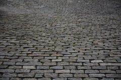 Cobble πέτρινο γκρι φωτογραφιών αποθεμάτων οδικού υποβάθρου Στοκ εικόνα με δικαίωμα ελεύθερης χρήσης