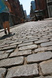 Walking on cobblestone street. Person walking on cobblestone street in Manhattan, New York Stock Image