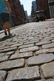 Walking on cobblestone street Stock Image