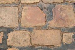 Cobble Achtergrond die in Teer wordt geplaatst Stock Afbeelding