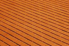 Cobble el modelo de piedra de la superficie del pavimento en tono anaranjado imagen de archivo
