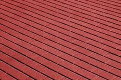 Cobble el modelo de piedra de la superficie del pavimento en tono rojo fotos de archivo