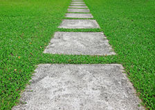 Cobble Path. On green grass royalty free stock photos