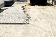 Cobble paving stone on the half of the street in the city reconstruction site Stock Photography