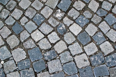 Cobble road Stone sidewalk background Stock Photos