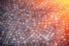 Cobble Steinstraßenhintergrund bei Sonnenuntergang, Italien europa Lizenzfreie Stockfotografie