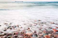 Cobble stone beach of Red Sea on sunset Royalty Free Stock Photography
