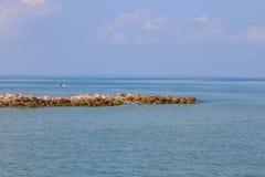 Cobble stone mole in sea Stock Image