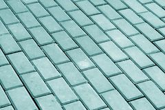 Cobble stone pavement in cyan tone. Stock Images