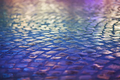 Cobble Stone Pavement - Reflexion in Urban Night. Wet Blue Sidewalk Stock Photos