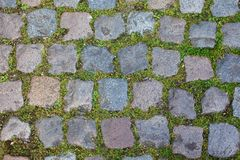 Granite roadway. Cobble Stone Road Background. Old pavement Granite roadway Royalty Free Stock Photos