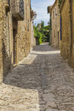 Cobble stone street path in Peretallada, Catalonia. Royalty Free Stock Photography