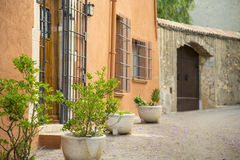 Cobble stone streets with jails in an orange wall Royalty Free Stock Photo