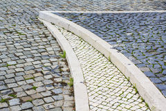 Cobble-stoned pavement. Three tipes of cobble-stoned pavement on the same street in Lisbon, Portugal Royalty Free Stock Photo