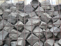 Cobble Stones in a cage Royalty Free Stock Photos