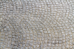 Cobble stones making curved pattern. Royalty Free Stock Photography