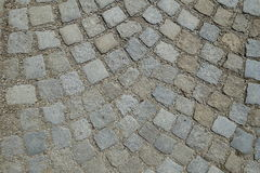 Cobble Stones Street Paving Rounded Background. Cobble stones on a street grey color in rounded lines royalty free stock photography