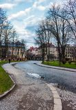 Cobble street winding through old town. Lovely cityscape in springtime. location Narodna square, Uzhgorod, Ukraine Stock Image