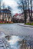 Cobble street winding through old town. Lovely cityscape in springtime. location Narodna square, Uzhgorod, Ukraine Royalty Free Stock Photo