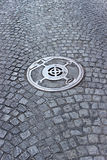 Cobble walkway with sewer cover Stock Images