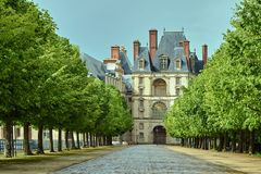 A cobbled alley in a park around the Fontainebleau Palace. In France stock image