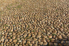 Cobbled, ancient stone road background Royalty Free Stock Photo