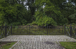 Cobbled area. With railing at the river bank Royalty Free Stock Image