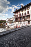 Cobbled Bridge. Medieval cobbled bridge under a cloudy blue sky un the famous village of Saint Jean Pied de Port - Basque Country - France stock images