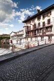 Cobbled Bridge. Medieval cobbled bridge under a cloudy blue sky un the famous village of Saint Jean Pied de Port - Basque Country - France Stock Images