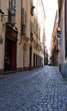 Cobbled central lane, city centre of Torino, Italy Royalty Free Stock Images