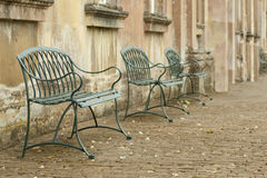 Cobbled courtyard. Row of seating in an old cobbled courtyard stock photography