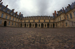 Cobbled courtyard of the palace Stock Photos