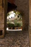 Cobbled entry and archway Moustiers France Stock Photography