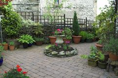 Cobbled garden Stock Images