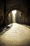 Cobbled old town street,  in the down, in the backgriund visible Royalty Free Stock Image