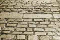 Cobbled Pathway. An image of a Cobbled Pathway in a historical town that could be useful as a textured background Royalty Free Stock Photo