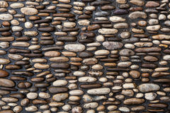 Cobbled pavement made of river rounded pebbles. Background textu Stock Image