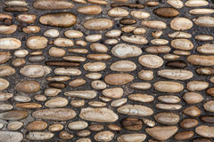 Cobbled pavement made of river rounded pebbles. Background textu Stock Photo