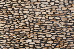 Cobbled pavement made of river rounded pebbles. Background textu Royalty Free Stock Photo