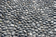 Cobbled paving. A close up of grey cobbled paving stock images