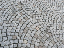 Cobbled road. Grey background with stones Royalty Free Stock Photos