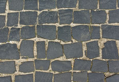 Cobbled road. Grey background with stones Royalty Free Stock Photography