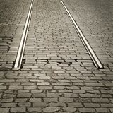 Cobbled road. With end( or beginning) of rails Stock Photos