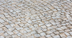 Cobbled road as background. Royalty Free Stock Image