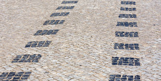 Cobbled road as background. Royalty Free Stock Images
