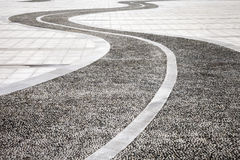 Cobbled road. A curved cobbled road in open space Stock Photo