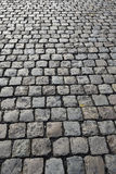 Cobbled road on industrial site Royalty Free Stock Images
